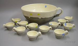 Phyllis Lester Glazed Art Pottery Figural Oversized Teacup Punchbowl and a Set of Twelve Matching Cups