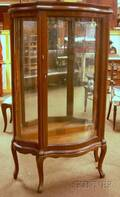 Early 20th Century Frenchstyle Carved Oak Serpentine Mirrored China Cabinet