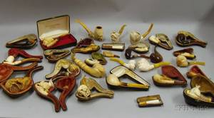 Twentyseven Carved Meerschaum Tobacco and Cheroot PipesHolders with Three Burlwood Tobacco Pipes