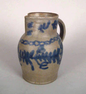 Blue decorated stoneware pitcher 19th c