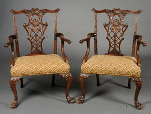 Pair of Centennial Chippendalestyle Carved Mahogany Open Armchairs