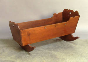 Walnut cradle with heart cutouts