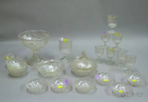 Twentytwo Pieces of Colorless Pressed Ribbed Ivy Pattern Glass Tableware