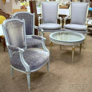 Two Pairs of Louis XVI Style Upholstered Carved and Painted Wood Armchairs and Glasstop Low Table