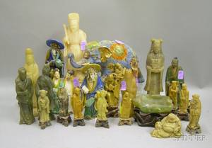 Twentytwo Chinese Pottery and Carved Stone Figures and an Asian Glazed Ceramic Elephant