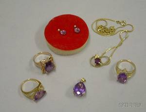 Three Gold and Amethyst Rings a Pair of Amethyst and Gold Earrings and a Amethyst and Gold Pendant