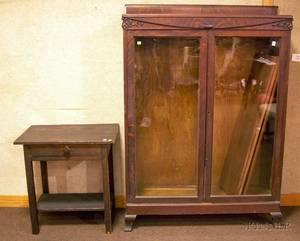 Early 20th Century Carved Oak and Oak Veneer TwoDoor Bookcase and a Mission Oak Stand