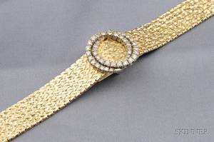 Ladys 14kt Gold and Diamond Covered Wristwatch Ebel