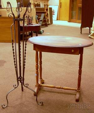 Wrought Iron Plant Stand and a Late Victorian Cottage Ovaltop Pine and Maple Occasional Table with Drawer