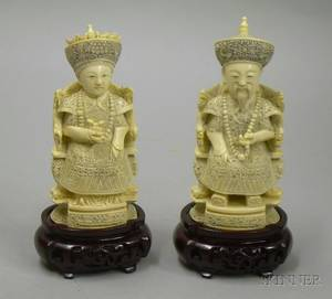 Pair of Carved Ivory Seated Officials with Wooden Stands