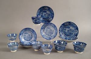Seven historical blue cups and saucers