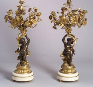 Pair of Louis XVIstyle Parcel Gilt Bronze Figural Eight Light Candelabra