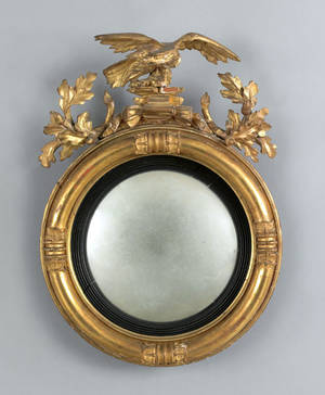 Regency carved giltwood convex mirror early 19th c