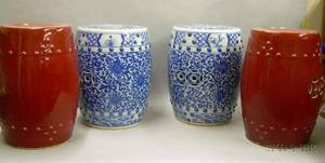 Pair of Chinese Red Glazed Porcelain Garden Seats and a Pair of Asian Blue and White Decorated Porcelain Garden Seats