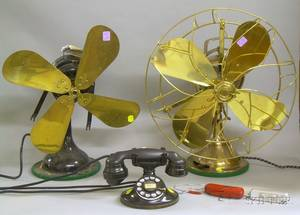 Two Vintage Electric Oscillating Table Fans a Western Electric Rotary Telephone and a Minox Spy Camera