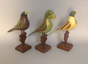 Three carved and painted birds in the manner of the Virginville carver