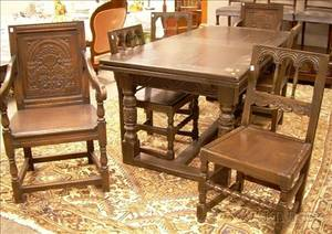 Kensington Furniture Jacobeanstyle Carved Oak Extension Dining Table and a Set of Eight Dining Chairs