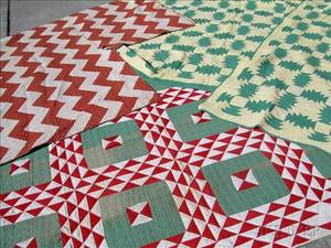 Two Pieced Cotton Quilts and a Pair of Pieced Cotton Quilts