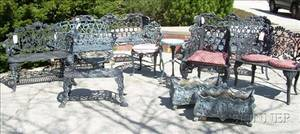 Thirteen Pieces of Painted Cast Metal Garden Furniture and Accessories