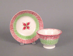 Red and green rainbow spatter cup and saucer 19th c