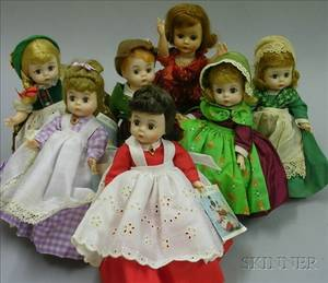Six Madame Alexander Dolls and One Vogue Plastic Doll