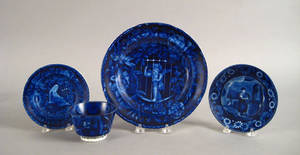 Two blue Staffordshire plates together with a cup and saucer 19th c