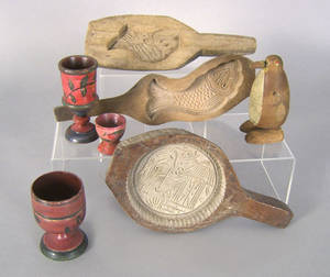 Three carved buttermolds together with three pieces of reproduction Lehnware and a carved penguin