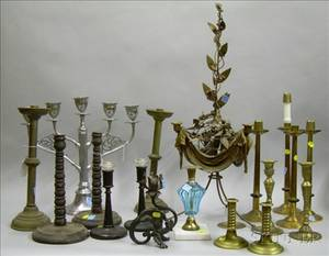 Sixteen Metal and Wooden Candlesticks a Candelabra and a Goldpainted Metal and Composition Candelabra