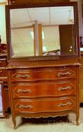 Frenchstyle Stained Pine Serpentine Dresser and a Mirror