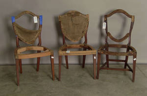 Three George III mahogany shieldback dining chairs