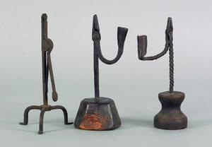 Three wrought iron rush light holders 18th c