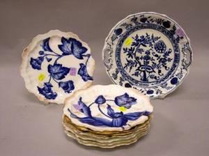 Set of Eight Gilt Flow Blue Floral Porcelain Plates and a Blue Onion Pattern Platter