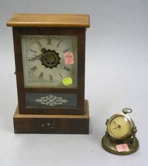 Waterbury Mahogany Veneered Cottage Clock and a Brass Cased Desk Clock