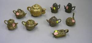 Nine Assorted Small Chinese and Asian Bronze and Metal Teapots