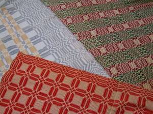 Two ThreeColor Woven Wool Coverlets and a Red and White Woven Wool Coverlet