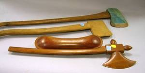 Two Folk Art Carved Wooden Axes and a Fraternal Tomahawk with Canoe Motif