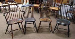 Two Windsor Bowback Side Chairs a Sackback Armchair and a Stepdown Side Chair