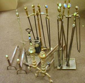 Pair of Brass Ringturned Andirons a Pair of Brass and Wrought Iron Andirons a Cast Iron Tool Stand Five Assorted Hearth Tools and