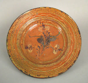 Large southern redware charger early 19th c