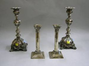 Pair of Rococo Revival Repousse Silver Plated Candlesticks and a Pair of Silver Plated Columnar Candlesticks