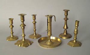 Five Georgian brass candlesticks 18th c