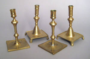 Two pair of brass platform base candlesticks 17th18th c