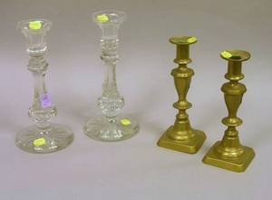 Pair of Colorless Cut Glass Candlesticks and a Pair of Brass Candlesticks
