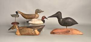 Four carved duck decoys