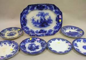Six Assorted Flow Blue Plates and a Flow Blue Scinde Pattern Platter