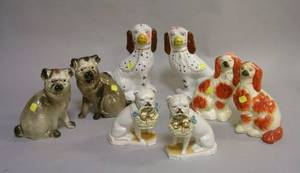 Two Pairs of Ceramic Pugs and Two Pairs of Staffordshire Spaniels