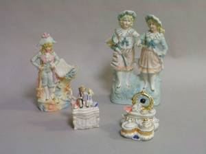 Two Porcelain Figural Trinket Boxes a Bisque Figural Group and Figural Vase