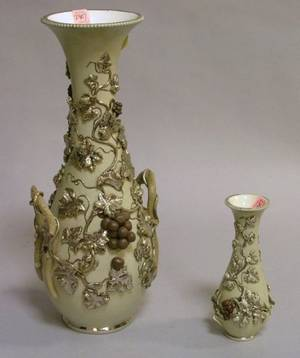 Two Silver Gilt Grapevine Decorated Drab Glazed Ceramic Vases