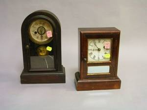 Seth Thomas Rosewood Veneer Cottage Shelf Clock and a Waterbury Clock Co Rosewood Grained Cottage Shelf Clock
