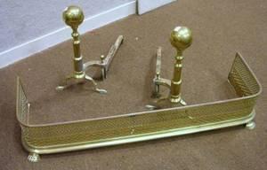 Pair of Brass Balltop Andirons and a Pierced Brass Fireplace Fender